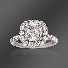 Breathtaking Henri Daussi halo-styled 3.12 ct. t.w. certified diamond Features 1.10 ct. t.w. of pave diamond rounds and cushion-cut center diamond of 2.02 carats.