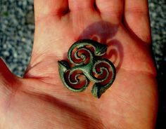 An ancient triskel brooch, still retains the delicate workmanship of it;s creator.