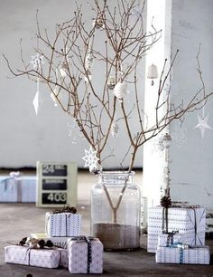 My sister and I did this one year as a centerpiece and lightly sprayed the branches with white glitter. Then we hung stained glass cookie ornaments on it. Everyone loved it.