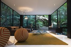 Living Room Window Walls of Forest House by Chris Tate, in Titirangi, New Zealand. Living Room Window Walls of Forest House by Chris Tate, in Titirangi, New Zealand. Auckland, Black Forest House, Glass Structure, Small Cottages, Living Room Windows, Living Rooms, Living Spaces, Box Houses, Window Wall