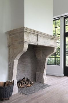 Big antique fireplace of french limestone in the Campagnarde style.