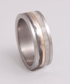 Hey, I found this really awesome Etsy listing at http://www.etsy.com/listing/167653544/antler-ring-titanium-ring-meteorite-ring