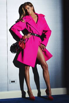 That girl showed off her red hot and sexy legs by wearing her red hot magenta pink coat.