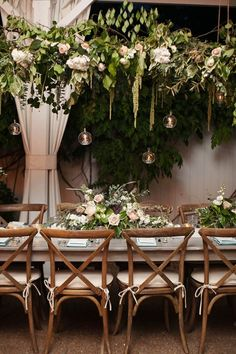 Love these hanging candles...so romantic! Organic Luxe Garden Wedding near Nashville. Love these grey farm tables and the muted blue, peach and green florals. Southern chic!  Venue: CJ's Off the Square Florist: The Enchanted Florist Rentals: Southern Events Party Rental Printed Pieces: Designs in Paper Lighting: Nashville Event Lighting Photography: Phindy Studios