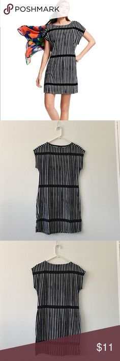"""🖤 Marimekko For Target  🖤NWOT 🖤 Versatile piece for vacation packing. Wear this as a dress with flats or heals. Change it up with white sneakers or flip flops for an afternoon of sight seeing. Use as an after shower caftan and your pool cover-up. Black and white terry cloth dress. 34"""" in total length. 18.5 inches across bust. Straight fit. Marimekko Dresses Mini"""
