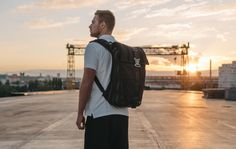 Premium quality, expandable, water-resistant backpack with a built-in waist bag and a hood for the owner
