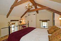 Galleried bedroom in a top spec Cornish stone barn conversion.