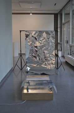 mobile flood ,48 x 24 in, mylar, fluorescent light, birch plywood, plexiglass, cotton digital print, casters, acetate digital print, photography backdrop, 2014
