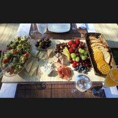 The right table setting can transform an outdoor picnic at the park into an elegant and romantic date for two. Food: Pesto tortellini pasta salad, an assortment of cheese and italian cold cuts, dried fruit and nuts, fresh fruit, rustic bread and crackers.