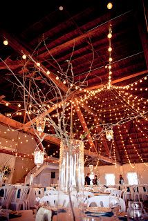 branch wedding centerpieces, maybe with electric tea lights so we don't have any accidents