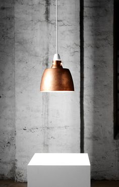 The clean simplistic form of the Hang on Honey Copper Pendant Lamp is countered by the raw industrial feel of the material.