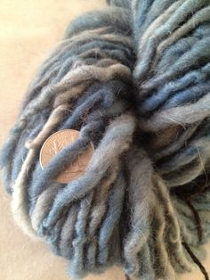 Soft blue squishy handspun yarn. Suffolk wool, perfect for a hat or fingerless gloves.