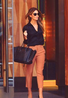 Lily Aldridge, adorable work outfit. Black bag, rust pants, black blouse.