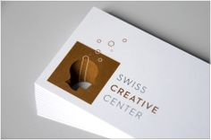 Swiss Creative Center | Carte de visite avec une impression Pantone cuivré et noir sur du papier Ispira Purezza avec découpe laser | by Contreforme Impression, Pantone, Creative, Business Cards, Design, Laser Cutting, Advertising Agency, Carte De Visite, Paper