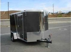 2016 New Haulmark TSTV6X10DS2, CARGO, BOX, COVERED, MOTORCYCLE, Toy Hauler in California CA.Recreational Vehicle, rv, 2014 HAULMARK TSTV6X10DS2, CARGO, BOX, COVERED, MOTORCYCLE,, CARGO, BOX, COVERED, MOTORCYCLE,, Black Ramp Exterior (1) Transport V-Nose Steel Frame Tag V-Front Flat Roof 10ft Long 6ft Wide 2in 5,000lb Coupler (1) 2in x 3in Tube Main Rails Crossmembers 24in On Center Z Crossmembers Standard Height Vertical Posts 16in On Center 72-3/4in Z Posts (1) 18in V-Nose Roof Bows 24in On…