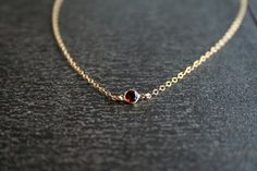 Hey, I found this really awesome Etsy listing at http://www.etsy.com/listing/117988378/gold-garnet-necklace-january-birthstone