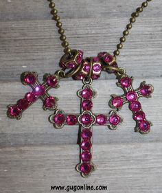 Save 10%  by using GUGREPBRITT at checkout!  www.gugonline.com Hot Pink Crystals on Three Bronze Crosses with Spacers on Long Chain