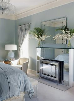 Soft french blue and mirror fireplace ...