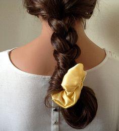 Scrunchie Styles That Won't Make You Feel Stuck in the 90′s   Made in the Braid: Make the scrunchie the focus of your look by styling it around the end of a cool braid.