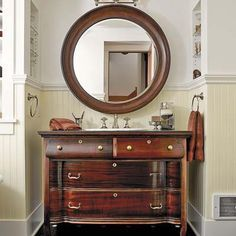 """A mahogany dresser, found at a local Salvation Army store, is transformed into a vanity topped with honed reclaimed slate. 