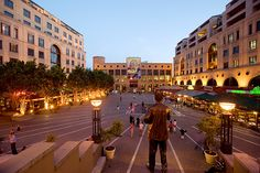 Nelson Mandela Square at dusk in Sandton, Johannesburg (Photograph by David Buzzard, Alamy)
