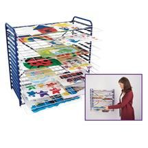 """Hanging/Tabletop Drying Rack     Mount it on the wall, or stand it on the table. Our versatile 16 sliding- shelf, Hanging/Tabletop Drying Rack saves space wherever you place it and allows children's artwork to dry flat!   Lightweight, but sturdy rack frame measures 26""""L x 18""""D x 26""""H    18""""D to accommodate artwork as large as 18""""L x 24""""W    Shelves sit 1-1/2"""" apart    Includes, rubber feet for tabletop use, hardware for mounting and an assembly guide    $82.95"""