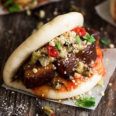 Melt in the mouth pork belly stuffed in soft, fluffy buns with sweet & spicy chili sauce & crunchy sour pickled mustard greens.