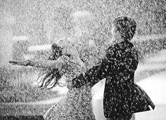 I want an engagement picture in the rain. I love this!