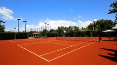 Fisher Island adds red clay courts to tennis center: Travel Weekly