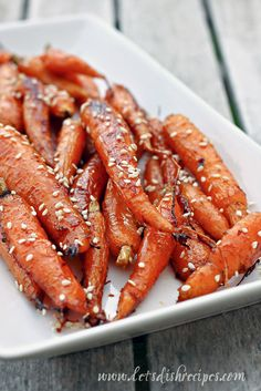 Honey Ginger Roasted Carrots - 1 pound carrots, peeled, 1/4 cup honey, 1/4 cup olive oil, 1-2 teaspoons fresh grated ginger, 1 tablespoon soy sauce, 1 clove garlic, minced 1 tablespoon brown sugar, Salt & pepper to taste, Sesame seeds for garnish. 400 degrees. Line a baking sheet with foil and spray with non-stick cooking spray. Bake for 15-25 minutes.