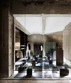 Brilliant shop design - raised floor with displays underneath