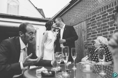 The bride and groom have an intimate moment during their wedding reception. Reportage wedding photography by Dorset wedding photographer.
