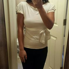 Cap sleeve shirt Ivory cap sleeve shirt with satin trim and beautiful back detail.  Keyhole with diamond closure. bebe Tops