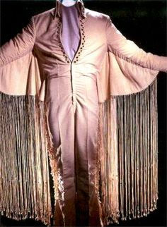 Elvis only wore one time. Elvis kept getting caught up in the fringe when He tried to move around on stage. Graceland, Costume Elvis, Elvis Memorabilia, Elvis In Concert, King Fashion, Long Fringes, White Jumpsuit, Stage Outfits, Suit And Tie
