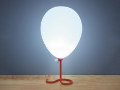 Balloons are happiness on a string. Add a little happiness to your home with this balloon lamp.