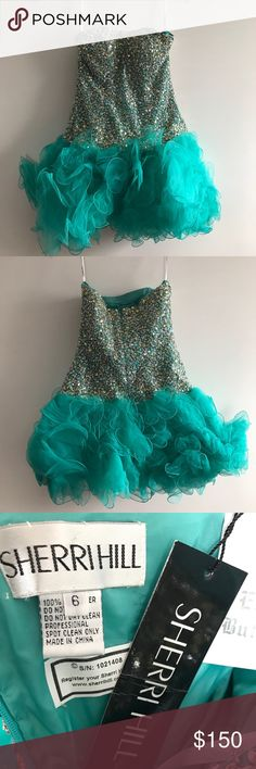 Tutu Prom Dress Short strapless prom dress by Sheri Hill. Sweetheart shaped neckline, sparkling embellishment over the corset bodice finished with a short tulle skirt Sherri Hill Dresses Prom