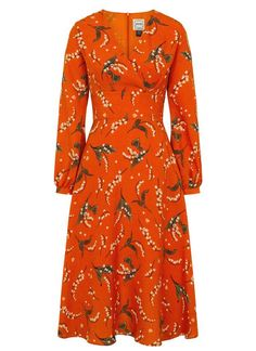Tiggy Floral Print Midi Dress is a 70s statement floral dress in burnt orange, with a cross-front V-neckline, wide waist panel and a discreet zipped back.