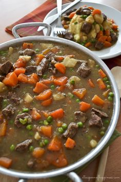 Irish beef stew with carrots, peas and parsnips served over mashed potatoes.