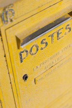 Send a postcard from your summer travels-Yellow mailbox in France.