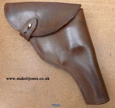 The classic Indiana Jones holster from Raiders of the Lost Ark. These replicas are hand cut, dyed, sewn, assembled and aged in the UK by Makeitjones. Available to order in assorted shades and levels of aging. Pistol Holster, Holsters, Revolvers, Indiana Jones, Ark, Raiders, Hand Sewn, Barrel, Sunglasses Case