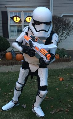 Storm Trooper Costume by Matt and Mom  Shin guards, a plastic coke bottle, white spray paint, foamy contact paper and a karate chest pad.