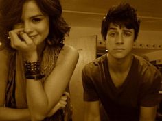 Selena Gomez and David Henrie this is funny. looks like selena pulled a prank off set.;)