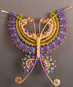 Love the mix of colourful micro-macramé and wirework. By Joan Babcock, who wrote a book on the subject.