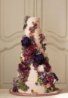 Romantic red and purple flower wedding cake; Featured Cake: Nadia & Co.