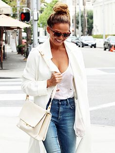 Chrissy Teigen white T-shirt, jeans and a white trench coat in LA