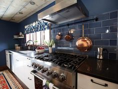 Trista's design plan took inspiration from the outdoor surroundings, deliberately bringing colors and themes of the natural surroundings indoors. A muted but rich blue was key in the color palette and reflective of the clear blue Colorado skies. As seen on HGTV's Rocky Mountain Reno.