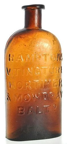 Hamptons V Tincture Mortimer & Mowbray, Baltimore, Yellow Copper, 6 inch A Hampton's V Tincture Mortimer & Mowbray, Baltimore glass medicine bottle in yellow copper color