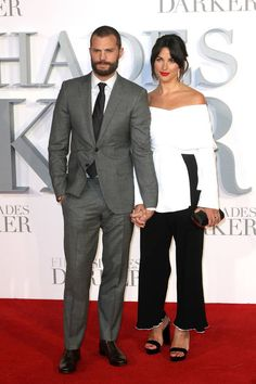Jamie Dornan and wife Amelia Warner at the London premiere of 'Fifty Shades Darker. Jamie Dornan And Wife, Greys Ana, Marine Corps Ball, Shades Of Grey Book, Anastasia Grey, Fifty Shades Series, Great Beards, Pose For The Camera, Fifty Shades Darker