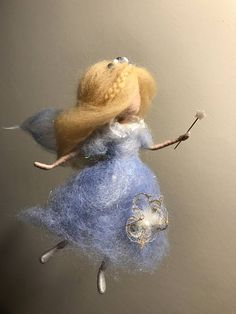 Needle felted angel is very gentle, cute and can be very nice ornament for Christmas, children room, or gift. The hight is 6, 15 cm.