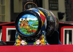 Canal Art Work Barge Ware Art or Canal Ware Art is a traditional British folk art. This highly decorative form of folk art once adorned t. Castle Painting, Boat Painting, Painting On Wood, Painted Milk Cans, Painted Wood, Canal Boat Art, Traditional Roses, Narrowboat, Mosaic Art